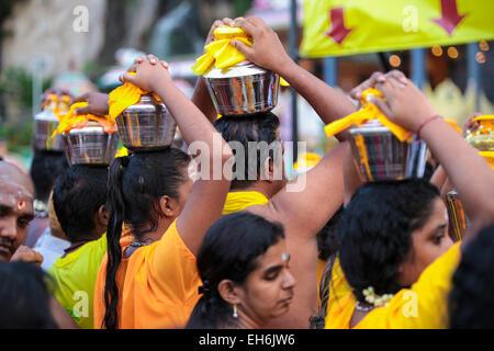 Hindu pilgrims with milk pot kavaldi queueing at Batu Cave temple, KL Malaysia during Thaipusam festival 3rd FEB - Stock Photo