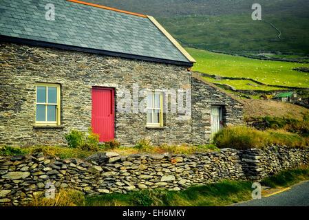 Stone house and sheep in pasture with stone fences on Slea Head Drive. Dingle Peninsula, Ireland. - Stock Photo