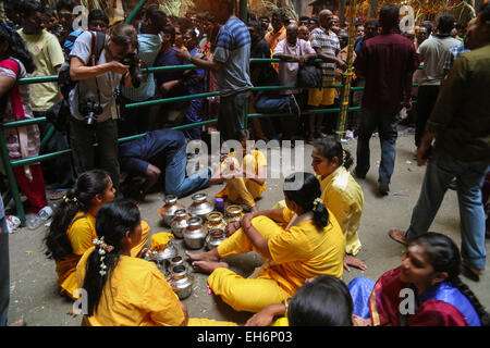 Happy lady pilgrims with kavaldi resting inside Batu Cave temple, Kuala Lumpur Malaysia during Thaipusam festival - Stock Photo