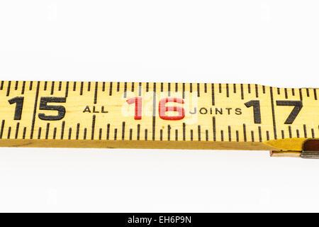 Wooden ruler shot on white background. - Stock Photo
