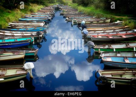 Fishing boats in small inlet. Killarney National Park, Ireland. - Stock Photo
