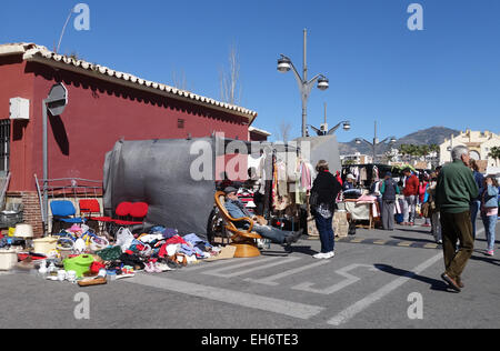 Stall and people walking on a weekly Flea Market, second hand market in Fuengirola, Spain. - Stock Photo
