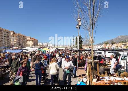 Fuengirola, Spain. Stall and people strolling on weekly Flea Market, second hand market in Fuengirola, Costa del - Stock Photo