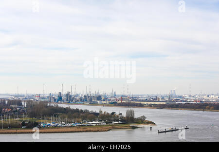 View on an oil refinery by the River Scheldt in the port of Antwerp, Belgium. Antwerp is the second largest port - Stock Photo