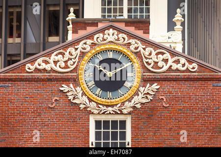 Clock on east facade of Old State House, State Street, Boston, Massachusetts, USA - Stock Photo