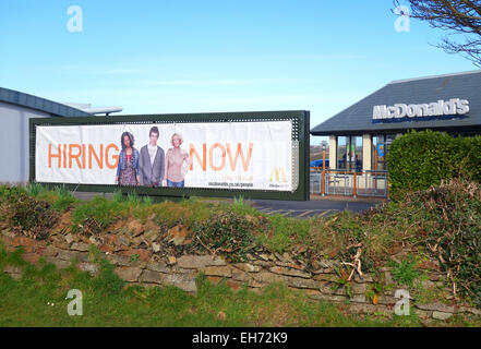 A ' Hiring Now ' sign outside a Mcdonalds restaurant in Cornwall, UK - Stock Photo