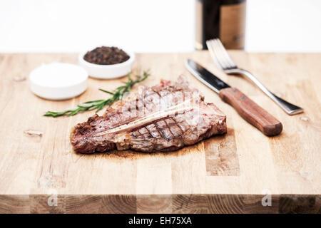 Juicy t-bone steak fresh of the grill - selective focus - Stock Photo