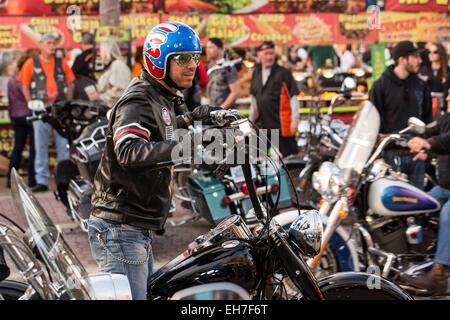 Daytona Beach, FL, USA. 8th Mar, 2015. A leather clad biker cruises down Main Street during the 74th Annual Daytona - Stock Photo