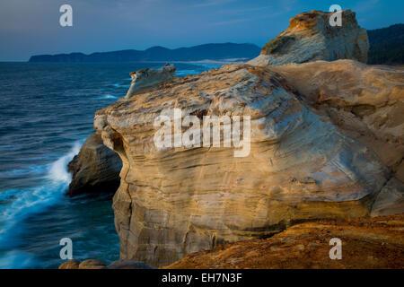 Dusk over rock formations along the coast at Cape Kiwanda, Oregon, USA - Stock Photo