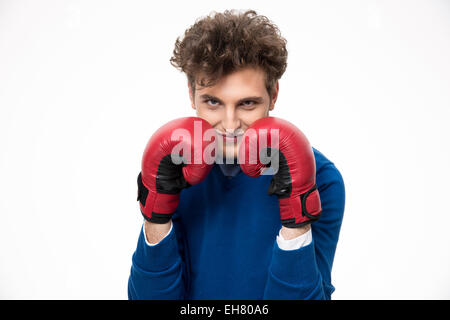 Businessman in boxing gloves over gray background - Stock Photo