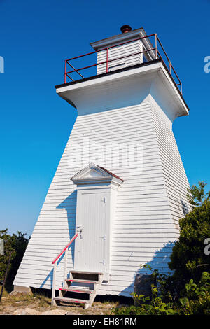 Abbott's Harbour Lighthouse in Nova Scotia, Canada - Stock Photo