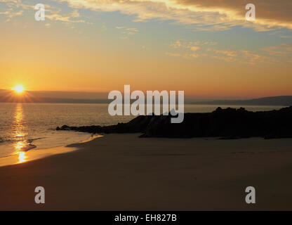 Sunrise across the bay of St Ives from Porthgwidden Beach Cornwall England Europe - Stock Photo