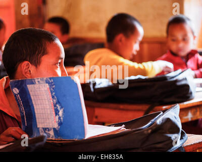 Boys in Buddhist monastery school in Lo Manthang, Mustang, Nepal - Stock Photo