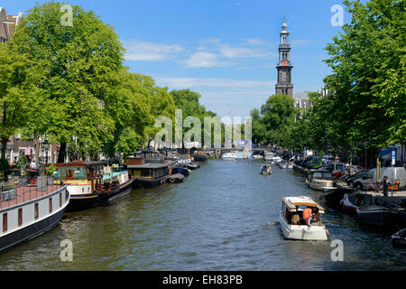 View along Prinsengracht canal, looking towards Westerkerk church, Amsterdam, North Holland, Netherlands, Europe - Stock Photo