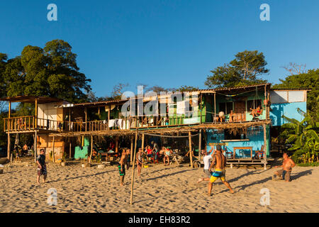 Volley ball and hostel at this lively beach north of San Juan del Sur, Playa Maderas, San Juan del Sur, Rivas, Nicaragua - Stock Photo