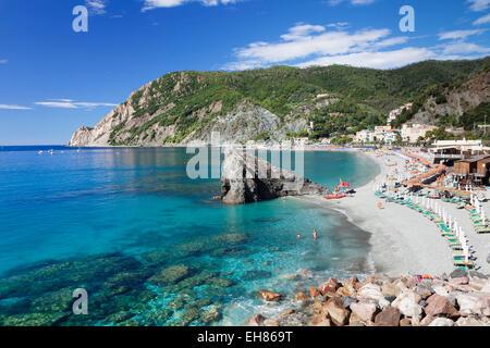 Beach with parasols and sun loungers, Monterosso al Mare, Cinque Terre, Rivera di Levante, UNESCO, Liguria, Italy - Stock Photo