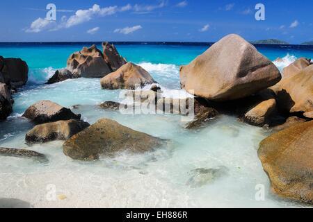 Granite rocks on Anse Patates beach, La Digue Island, La Digue and Inner Islands, Seychelles - Stock Photo