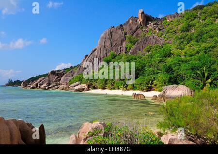 Rocky coast with tropical vegetation, La Digue Island, La Digue and Inner Islands, Seychelles - Stock Photo