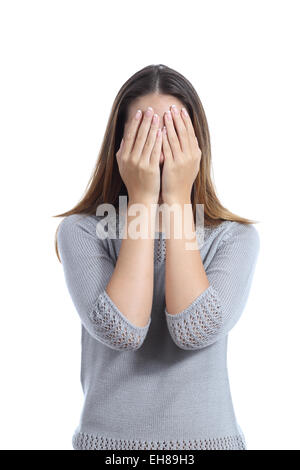 Woman covering her face with both hands isolated on a white background - Stock Photo