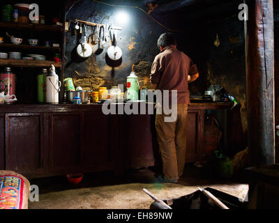 Dark kitchen of traditional tea house at Ghar Gompa, above Tsarang in Mustang, Nepal - Stock Photo