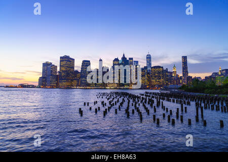 Lower Manhattan skyscrapers including One World Trade Center at sunset from across the East River, Manhattan, New - Stock Photo
