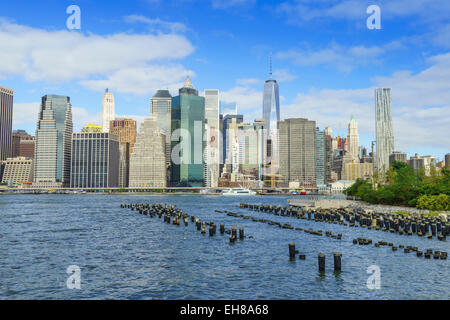 Lower Manhattan skyscrapers including One World Trade Center from across the East River, Manhattan, New York City, - Stock Photo
