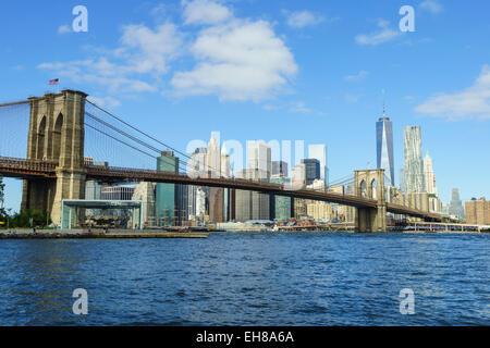 Brooklyn Bridge and Lower Manhattan skyscrapers including One World Trade Center, New York City, New York, USA - Stock Photo