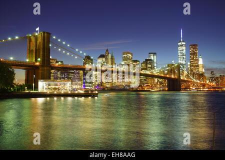 Brooklyn Bridge and Lower Manhattan skyline at night, New York City, New York, United States of America, North America - Stock Photo