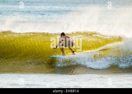 Surfer in barrel of this famous shore break wave near San Juan del Sur, Playa Maderas Beach, San Juan del Sur, Rivas, - Stock Photo