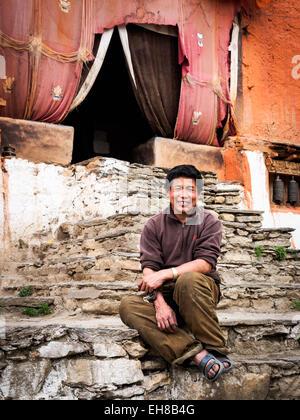 Lone monastery caretaker at Ghar Gompa, above Tsarang in Mustang, Nepal. - Stock Photo