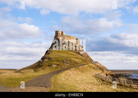 Path to Lindisfarne castle built high a on rocky outcrop. Holy Island, Northumberland, England, UK, Britain - Stock Photo