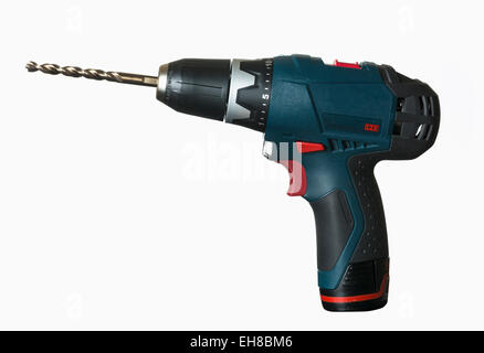 Cordless drill with large bit on white background - Stock Photo