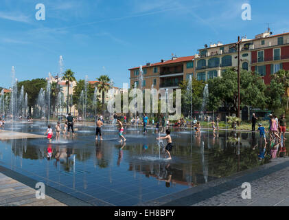 Nice, France, Europe - Promenade du Paillon water mirror fountain in the city center with people in summer - Stock Photo