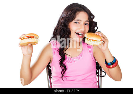 1 indian Young girl Teenager Delicious Burger Eating - Stock Photo