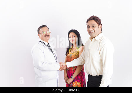 3 indian people doctor and Married Couple Health Treatment Shaking Hand - Stock Photo