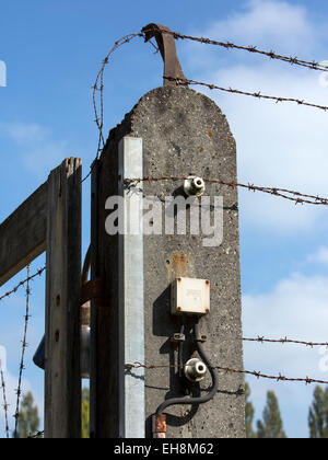 Dachau Concentration Camp, Germany, electric barbed wire security fence - Stock Photo