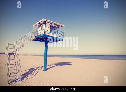 Vintage retro style picture of a lifeguard tower. - Stock Photo