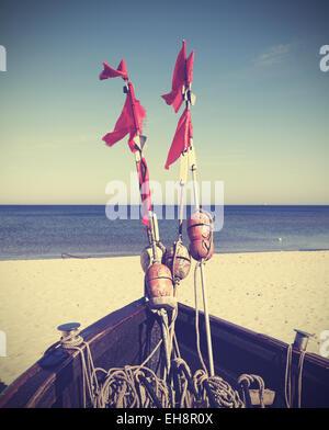 Retro filtered photo of fishing boat on beach, Baltic Sea, Germany. - Stock Photo
