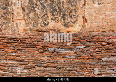 layers of handmade medieval clay red tiles used in wall of kitchen as heat resistant and wont crack like sandstone - Stock Photo