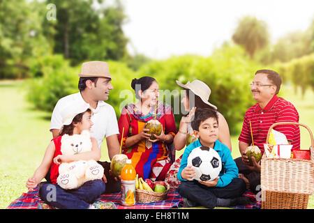 indian group crowds grand Parents park Picnic - Stock Photo