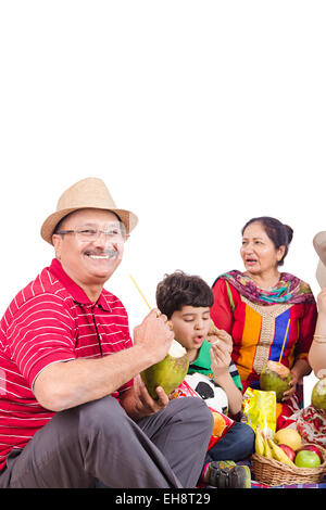 4 indian grand Parents  Picnic drinking Coconut fruits - Stock Photo