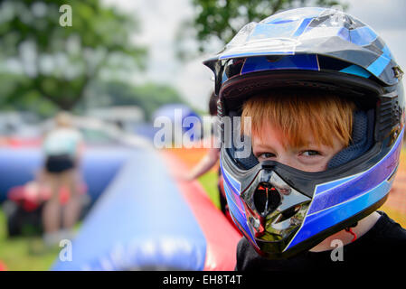 Young boy wearing motorcycle helmet, safety concept - Stock Photo