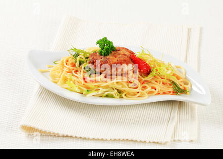 Meat patty with spaghetti and spicy sauce - Stock Photo