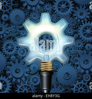 Light bulb with gears business concept as a light shaped as a cog wheel with machine parts in the background as - Stock Photo
