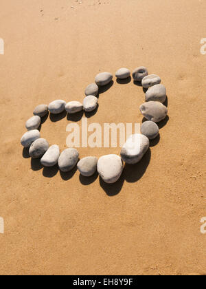 Heart shape on beach made of pebbles - Stock Photo