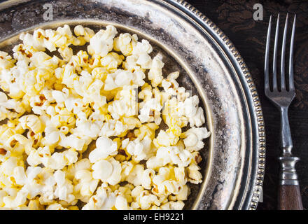 Healthy Buttered Popcorn with Salt in a Plate - Stock Photo