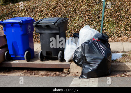 Trash bins left out for collection - USA - Stock Photo