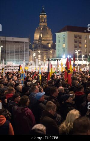 Dresden, Germany. 09th Mar, 2015. Supporters of the anti-Islam 'Pegida' movement have gathered on the Altmarkt in - Stock Photo