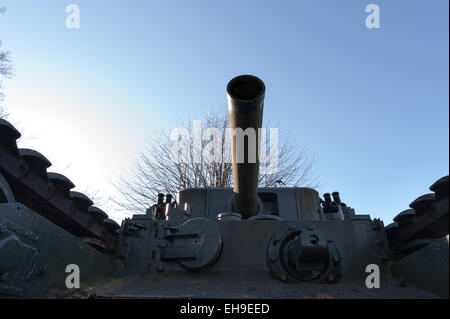 Almost looking down the gun barrel to a British tank armored vehicle now peace keeper - Stock Photo