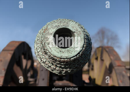 looking down the barrel Weathered patina on Light British copper bronze field cannon gun with fine decoration and - Stock Photo